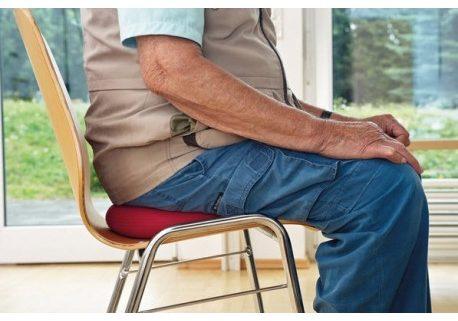 Cojín dinar y evitar dolor de espalda